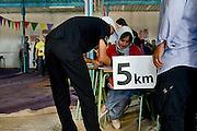 Salah Ameidan registers for the 5km race during the annual Sahara Marathon in Samara, a Sahrawi refugee camp in southwestern Algeria.