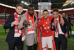 Bristol City's Wes Burns, Karleigh Osborne, Korey Smith and Bobby Reid celebrate the win against Walsall in the Johnstone Paint Trophy final - Photo mandatory by-line: Dougie Allward/JMP - Mobile: 07966 386802 - 22/03/2015 - SPORT - Football - London - Wembley Stadium - Bristol City v Walsall - Johnstone Paint Trophy Final