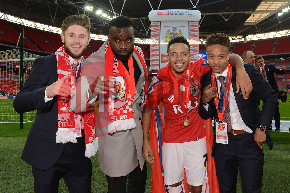 Bristol City's Wes Burns, Karleigh Osborne, Korey Smith and Bobby Reid celebrate the win against Walsall in the Johnstone Paint Trophy final - Photo mandatory by-line: Dougie Allward/JMP - Mobile: 07966 386802 - 22/03/2015 - SPORT - Football - London - Wembley Stadium - Bristol City v Walsall - Johnstone Paint Trophy Final