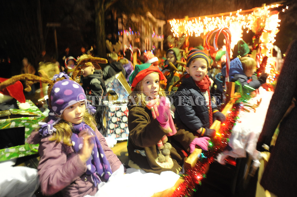 The Oxford University School float rides on North Lamar in the Christmas parade in Oxford, Miss. on Tuesday, December 6, 2011.