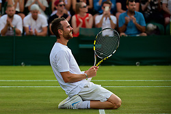 LONDON, ENGLAND - Friday, July 6, 2018: Adrian Mannarino (FRA) celebrates after his victory during the Gentlemen's Singles 3rd Round match on day five of the Wimbledon Lawn Tennis Championships at the All England Lawn Tennis and Croquet Club. (Pic by Kirsten Holst/Propaganda)