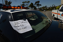 59537054.A note of bomb threat is tagged on a police vehicle at the neighbourhood of the campus of the California State University Los Angeles (CSULA) in Los Angeles, April 18, 2013. The campus of the California State University Los Angeles (CSULA) is being evacuated Thursday due to a bomb threat. The CSULA announced the evacuation around noon, through loud speakers on the campus and Twitter, as a precaution, but did not provide additional information. Most of students and staff have been evacuated., April 18, 2013,  Friday 19, April. Photo by: i-Images.UK ONLY