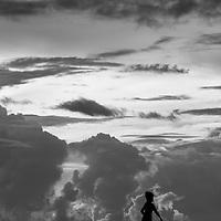 Where - Madura Island, Indonesia. A local boy walks along a pier.