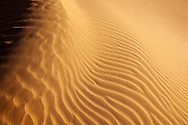An image of desert sand pattern from the Sahara desert in Morocco.