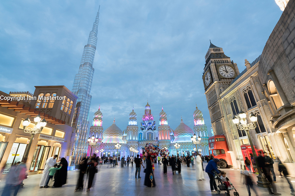 Evening view of international pavilions at Global Village 2015 in Dubai United Arab Emirates