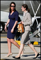 Kate's private secretary Rebecca Deacon (left) and George's nanny Maria Teresa Turrion Borrallo arrive is Sydney as The Duke and Duchess of Cambridge arrive at Sydney airport, Australia, with Prince George on day 10 of their Royal Tour of New Zealand and Australia, Wednesday, 16th April 2014. Picture by  i-Images