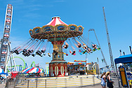 Seaside NJ, USA -- August 21, 2017.  The  Wave Swinger  is in motion at the Pier in Seaside Heights. Editorial Use Only.
