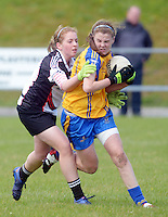 Clare's Captain Chloe Moloney breaks through despite efforts from Sligo's  Aimee Oates in the All ireland U14 C championship final in Kilkerrin-Galway Photo: Andrew Downes..