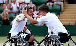 Gordon Reid (right) and Alfie Hewett celebrate winning the Gentlemen's Wheelchair Doubles final on day twelve of the Wimbledon Championships at the All England Lawn Tennis and Croquet Club, Wimbledon. PRESS ASSOCIATION Photo. Picture date: Saturday July 14, 2018. See PA story TENNIS Wimbledon. Photo credit should read: Nigel French/PA Wire. RESTRICTIONS: Editorial use only. No commercial use without prior written consent of the AELTC. Still image use only - no moving images to emulate broadcast. No superimposing or removal of sponsor/ad logos. Call +44 (0)1158 447447 for further information.