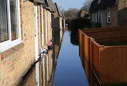 © Licensed to London News Pictures. 24/02/2014. Basingstoke, Hampshire, UK. Floodwater surrounding houses on Grampian Way in the Buckskin area of Basingstoke, Hampshire. Groundwater levels are continuing to rise in the area, forcing 69 homes to be evacuated in the Buckskin Area of the commuter town. Photo credit : Rob Arnold/LNP