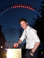Eddie Redmayne, as patron of the Motor Neurone Disease Association (MND), turns the Coca-Cola London Eye, blue and orange, in support of the charity's Global Awareness Day.