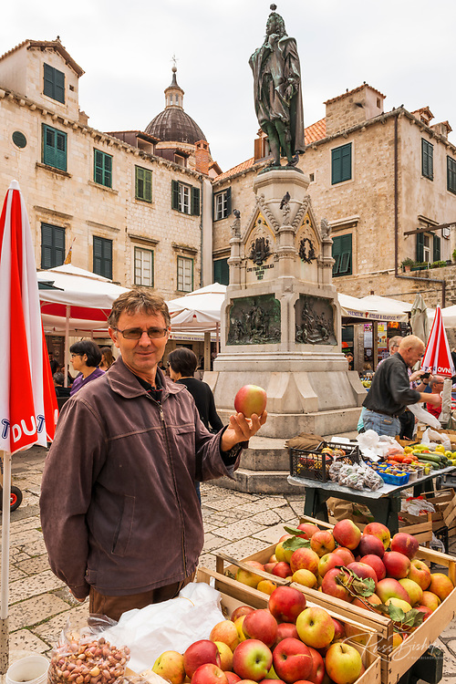 Man showing his apples at the Farmers Market, Dubrovnik, Dalmatian Coast, Croatia