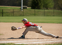 Laconia first baseman Graham Nyhan stretches out to make a play at first during varsity baseball with White Mountain at Robbie Mills Field Friday afternoon.  (Karen Bobotas/for the Laconia Daily Sun)