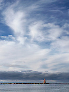 A Chaotic Cloudscape Looming Over The Manistique East Breakwater Light On A Stormy Lake Michigan Morning, Michigan's Upper Peninsula, USA