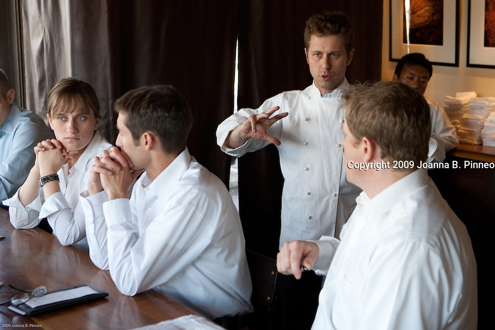 Chef Lachlan Mackinnon-Patterson describes the special dishes of the evening at pre-service to the staff before the evening guests arrive at Frasca, an award-winning restaurant in Boulder, Colorado.