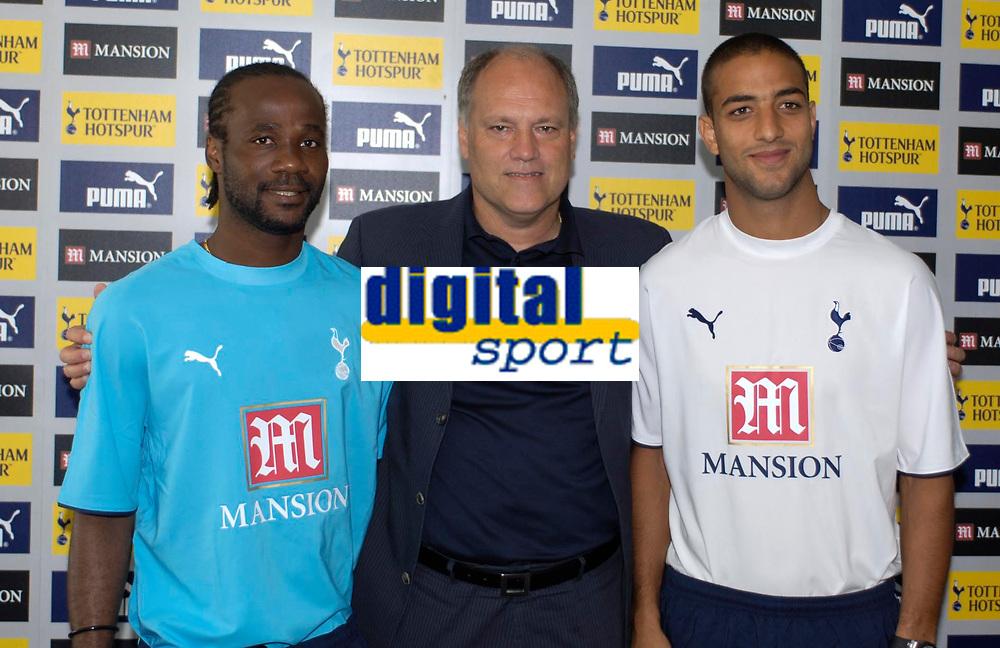 Photo: Daniel Hambury.<br />Tottenham Hotspur press conference. 07/09/2006.<br />Tottenham manager Martin Jol (C) with new signings Pascal Chimbonda (L) and Mido.