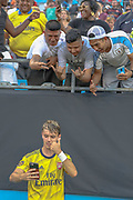 Arsenal midfielder Robbie Burton (41) takes a selfie with fans in the stands in a game against Fiorentina during an International Champions Cup game, Saturday, July 20, 2010, in Charlotte, NC. Arsenal defeated Fiorentina 3-0. (Brian Villanueva/Image of Sport)