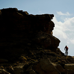 A racer climbs the series of switchbacks on Third Mesa.
