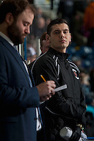 KELOWNA, CANADA - FEBRUARY 1: Calgary Hitmen athletic therapist Kyle Vouriot stands on the bench against the Kelowna Rockets on February 1, 2017 at Prospera Place in Kelowna, British Columbia, Canada.  (Photo by Marissa Baecker/Shoot the Breeze)  *** Local Caption ***