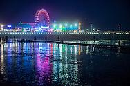 The Santa Monica Pier at night in Los Angeles, California.