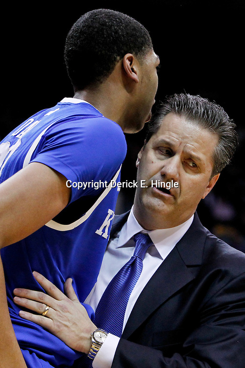January 28, 2012; Baton Rouge, LA; Kentucky Wildcats head coach John Calipari checks on forward Anthony Davis (23) after he is fouled hard by LSU Tigers forward Malcolm White (not pictured) during the second half of a game at the Pete Maravich Assembly Center. Kentucky defeated LSU 74-50.  Mandatory Credit: Derick E. Hingle-US PRESSWIRE
