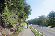 Female cyclist on a cycling path at the outskirts of Linz, Austria. Model release available