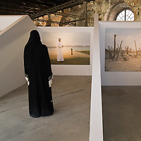 VENICE, ITALY - JUNE 02:  Artist Lateefa bint Maktoum looks at one of her works inside the United Arab Emirates pavillion on June 2, 2011 in Venice, Italy. This year's Biennale is the 54th edition and will run from June 4th until 27 November.
