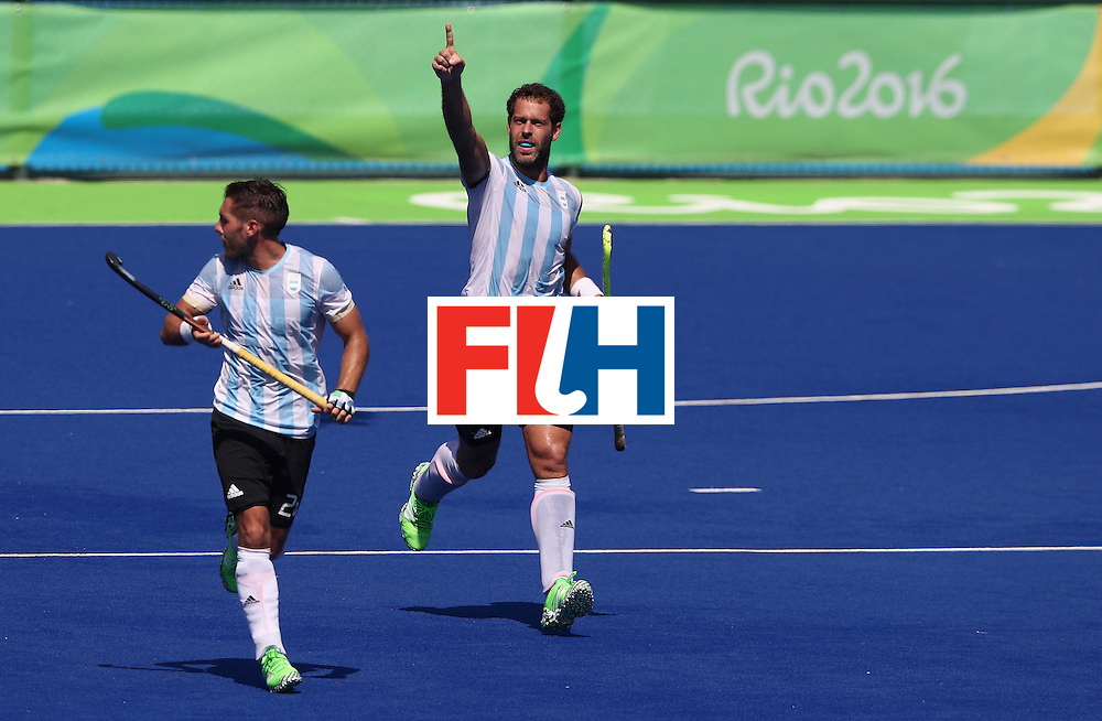 RIO DE JANEIRO, BRAZIL - AUGUST 14:  Juan Gilardi of Argentina celebrates after scoring a late match winning penalty during the Men's hockey quarter final match between Spain and Argentina on Day 9 of the Rio 2016 Olympic Games at the Olympic Hockey Centre on August 14, 2016 in Rio de Janeiro, Brazil.  (Photo by David Rogers/Getty Images)