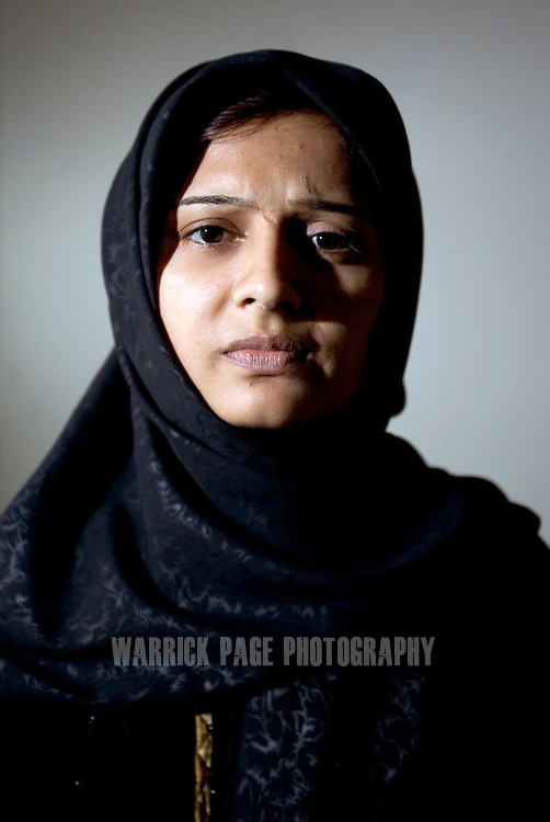 """ISLAMABAD, PAKISTAN - NOVEMBER 18: Twenty one-year-old Nussarat recalls her experience of being raped by a feudal landlord in retribution for marrying without her family's consent, November 18, 2006, Islamabad, Pakistan. Nussarat was forced to sign divorce papers after being taken to a warehouse where she was tied to a bed, gagged with a turban and raped repeatedly at knifepoint before being thrown out a window into an open sewer drain. Nussarat's village and family have since ordered her to be killed and human rights groups and politicians have refused and resisted her attempts to seek justice. Nussarat has since remained in hiding with her husband, moving across the Punjab from one hotel to the next, and lives in constant fear. Until recently, rape cases in Pakistan fell under the """"Hudood Ordinance"""" and were dealt with in the Sharia (Islamic) Courts. Four Muslim male witnesses were required to prosecute; otherwise the victim risked being imprisoned for adultery. A recent amendment has paved the way for rape cases to now be tried in civil courts. (Photo by Warrick Page)"""