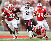 Sept 15, 2012; Dallas, TX, USA; Texas A&M Aggies quarterback Johnny Manziel (2) breaks a tackle attempt by Southern Methodist Mustangs defensive tackle Aaron Davis (93) and rushes for a touchdown during the second quarter at Gerald J. Ford Stadium. Mandatory Credit: Thomas Campbell-US PRESSWIRE