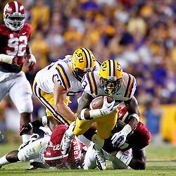 November 3, 2012; Baton Rouge, LA, USA;  LSU Tigers running back Jeremy Hill (33) runs against the Alabama Crimson Tide during a game at Tiger Stadium. Alabama defeated LSU 21-17. Mandatory Credit: Derick E. Hingle-US PRESSWIRE