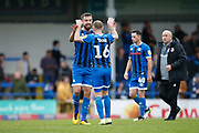 Eoghan O'Connell of Rochdale  and Matt Done of Rochdale   celebrate at full time  during the EFL Sky Bet League 1 match between Rochdale and Accrington Stanley at the Crown Oil Arena, Rochdale, England on 12 October 2019.