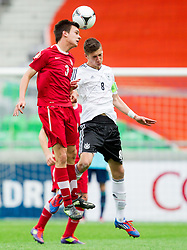 Konrad Budek of Poland vs Leon Goretzka of Germany during the UEFA European Under-17 Championship Semifinal match between Germany and Poland on May 13, 2012 in SRC Stozice, Ljubljana, Slovenia. Germany defeated Poland 1-0 and qualified to finals. (Photo by Vid Ponikvar / Sportida.com)
