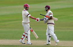 Somerset's Jim Allenby and Peter Trego shake hands after reaching 100 partnership. - Photo mandatory by-line: Harry Trump/JMP - Mobile: 07966 386802 - 17/06/15 - SPORT - CRICKET - LVCC County Championship - Division One - Day Four - Somerset v Nottinghamshire - The County Ground, Taunton, England.