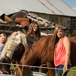 Sisters with horses.