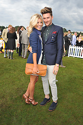 MOLLIE KING and HENRY HOLLAND at the 2012 Veuve Clicquot Gold Cup Final at Cowdray Park, Midhurst, West Sussex on 15th July 2012.