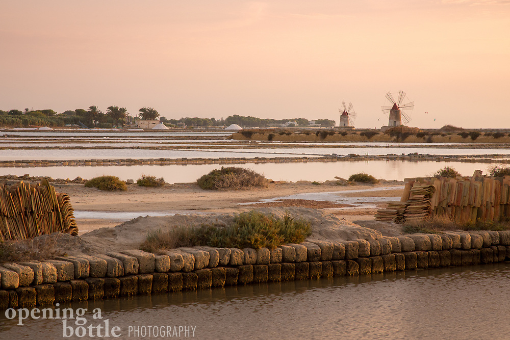 Windmills and salt flats at sunset, Trapani, Sicily.