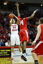 30 December 2010: Katie Broadway resorts to a fading jump shot to get past Raisa Taylor during an NCAA Womens basketball game between the Bradley Braves and the Illinois State Redbirds at Redbird Arena in Normal Illinois.