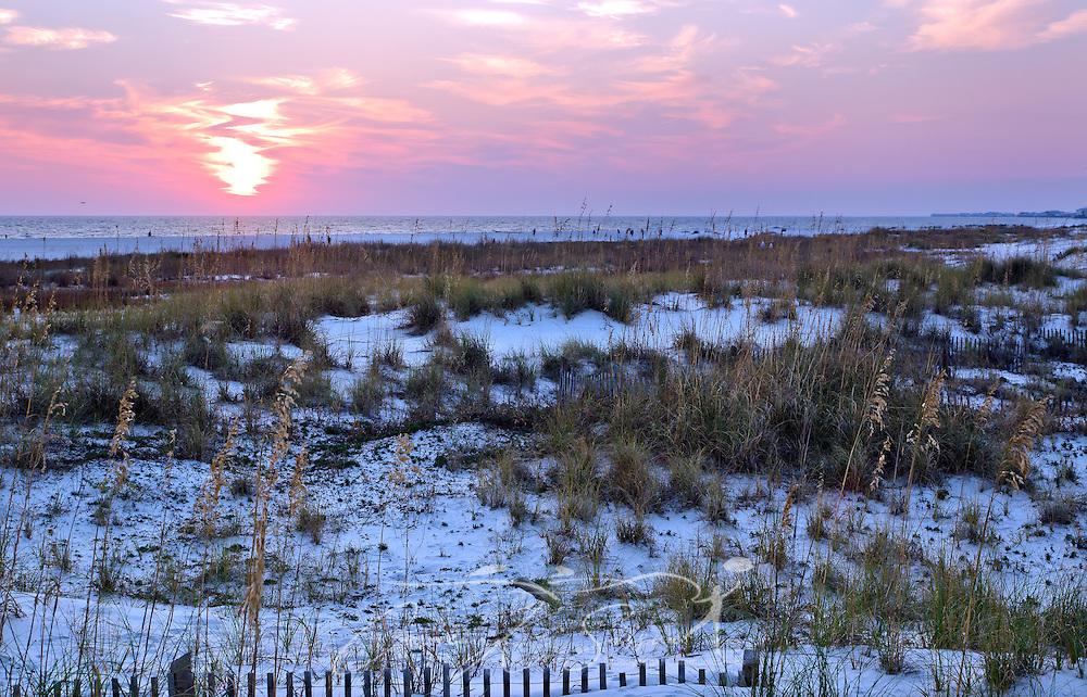 The sun sets on Dauphin Island, Alabama. (Photo by Carmen K. Sisson/Cloudybright)