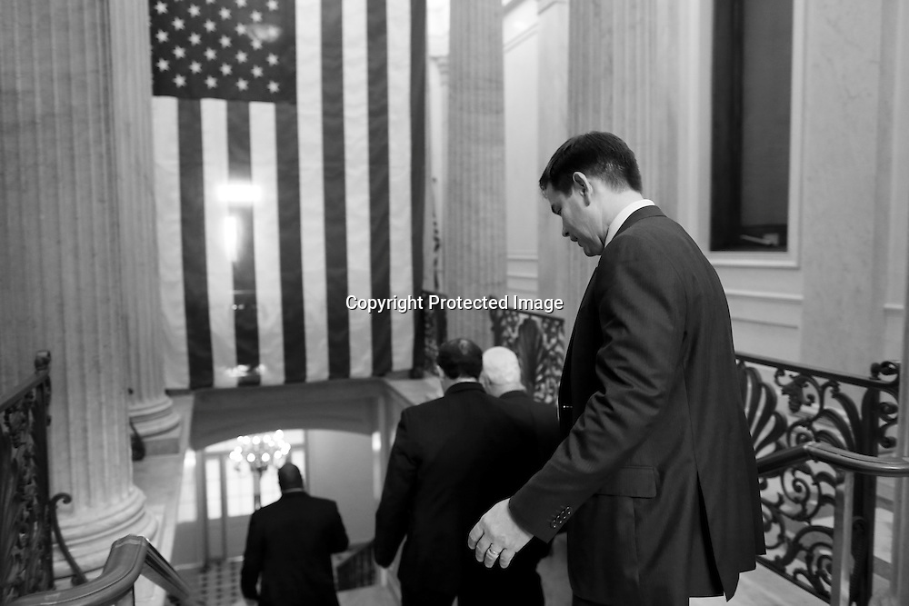 U.S. Senator Marco Rubio (R-FL) (R) departs after a Republican Senate caucus meeting at the U.S. Capitol in Washington, October 16, 2013. U.S. Senate leaders struck a bipartisan 11th-hour deal to break the fiscal impasse on Wednesday, and the Republican-led House of Representatives agreed to take it up as Congress moved to avert a historic debt default.
