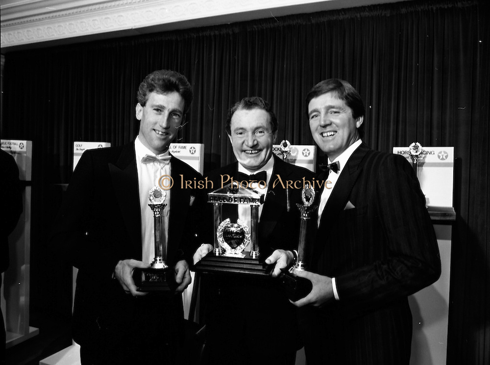 18/01/1989<br /> 01/18/1989<br /> 18 January 1989<br /> Texaco Sportstars of the Year Awards 1988 at the Burlington Hotel, Dublin. Picture shows  (l-r): Sean Kelly (Tipperary, Cycling); addy Hopkirk (Antrim, Hall of Fame Motor Sport) andDes Smyth (Meath, Golf) with their awards.