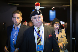© Licensed to London News Pictures . 29/09/2013 . Manchester , UK . Colonel Ian Brazier , Chairman of the Fusiliers ' Association chairman , walks out of the conference hall after heckling Philip Hammond from the audience . Day 1 of the Conservative Party Conference at Manchester Central . Photo credit : Joel Goodman/LNP