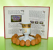 Pesach (Passover) concept image with Haggadah, Hard boiled egg and nuts