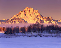 Winter sunrise over Mount Moran, Grand Teton National Park Wyoming USA