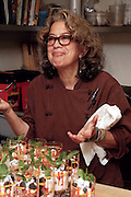 Susan Feniger tasting in the kitchen