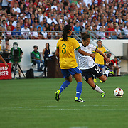 U.S. midfielder Carli Lloyd (10) runs with the ball during a women's soccer International friendly match between Brazil and the United States National Team, at the Florida Citrus Bowl  on Sunday, November 10, 2013 in Orlando, Florida. The U.S won the game by a score of 4-1.  (AP Photo/Alex Menendez)