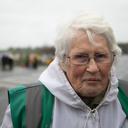 "Anne Power.<br /> ""I am Anne Power, I love my second name and I have just had my 87th birthday. What is going on here is a bit mysterious, my sense is the tide is turning, this site here which has been trying desperately hard to frack, causing earth quakes, is closing down, or something big is changing. Lots of equipment has gone, there is no tower which is a huge symbol."" It is Green Monday and first week of the second anniversary of Cuadrilla's fracking exploration in Preston New Road. For two years activists have been keeping an eye on the fracking company Cuadrilla from the roadside of the fracking site in Preston New Road. The company has not actively fracked since November and is currently seemingly busy emptiyng the site for heavy equipment. Prostesters and climate protectors are still by the gates trying to work out Cuadrilla's intensions."