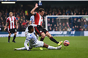 Leroy Fer tackles Michael Doyle during the The FA Cup match between Queens Park Rangers and Sheffield Utd at the Loftus Road Stadium, London, England on 4 January 2015. Photo by David Charbit.
