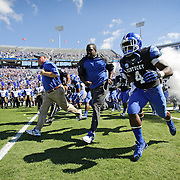 UK head coach Mark Stoops leads his team on the field before the University of Kentucky plays the University of Louisville at Commonwealth Stadium in Lexington, Ky. Saturday Sept. 14, 2013. Photo by David Stephenson