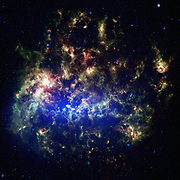 Spitzer Space Telescope image of the Large Magellanic Cloud, a satellite galaxy to our own Milky Way galaxy. The infrared image, a mosaic of 300,000 individual tiles, offers astronomers a unique chance to study the lifecycle of stars and dust in a single galaxy. Nearly one million objects are revealed for the first time in this Spitzer view, which represents about a 1,000-fold improvement in sensitivity over previous space-based missions. Most of the new objects are dusty stars of various ages populating the Large Magellanic Cloud; the rest are thought to be background galaxies. The blue colour in the picture, seen most prominently in the central bar, represents starlight from older stars.